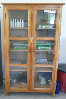Medicine cabinet containing herbal remedies and balms